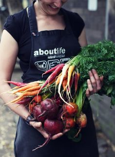 One of our Chefs coming from the organic gardens with the harvest for tonights dinner salad.