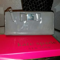 Kate spade wallet Patented. Grey with pretty navy blue lining. Greater condition. .. downsizing collection for new ones :) any questions just ask. kate spade Accessories