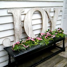 Would love to get these distressed letters in red and have them spell JOY and NOEL and put them in my window boxes.