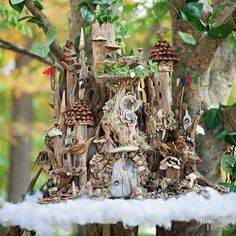 At 10 Cloud Lane, the intricate giant's castle from Jack and the Beanstalk hovers in a dogwood tree. Although artists Carol Hall-Jordan and Kathryn Stocking-Koza suspended the castle in cotton clouds, it's actually kid height.