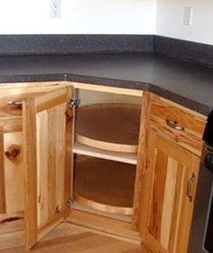 Lazy susan inspired corner cabinets take advantage of otherwise ...
