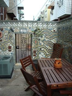 Mosaic walls.... Perfect for city.... And absolutely cool for suburban space too! I would install something like this on an exterior fireplace wall below mantle!