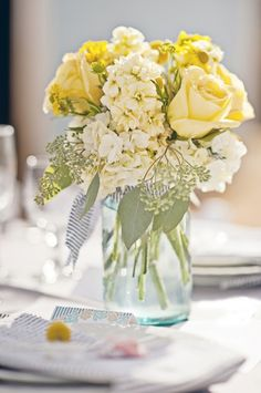 Pretty centerpiece with pale yellow flowers in a mason jar...This is beautiful! Exactly what I want for colors and flowers. :)