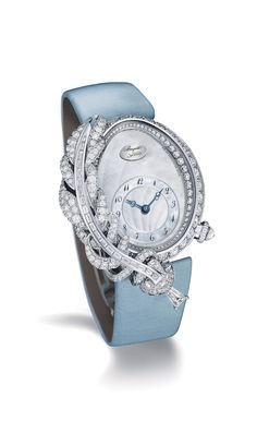 Breguet watches Rêve de Plume high jewellery timepiece draws inspiration from the quill ink pen used by Queen Marie-Antoinette. The white gold model features a feather positioned on the left side of the bezel. More than 4.00 carats of diamonds in different cuts have been employed to decorate the ladies' watch.