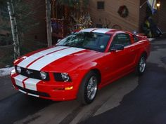 Image result for 2007 ford mustang cherry red with white racing stripes