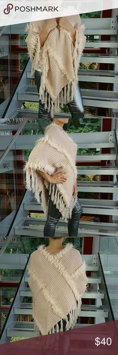 Blush pink poncho with faux fur details NWT Brand new with tags   Stay warm and look chic in this blush pink knitted poncho with faux fur details! Pair with classy pants and heels or with your favorite jeans and boots!  One size per tags Material 100% acrylic   💖Shop with confidence💖💖 🎉🎊Suggested User🎊🎉 📮💌Same day shipping📮💌 5🌟🌟🌟🌟🌟 star rated closet 👍👍Top seller👍👍 Sweaters Shrugs & Ponchos