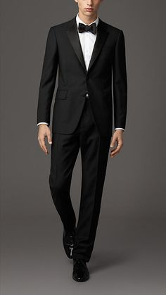 Burberry Black Classic Fit Wool Mohair Tuxedo - A classic fit wool and mohair blend tuxedo with notch satin lapels. The jacket has a part-canvas construction. With a layer of natural horsehair at the chest, the canvassing moulds to the cut of the jacket, creating a light handle and a clean silhouette.