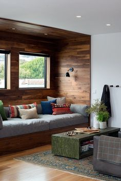 San Francisco Interior Design company Regan Baker Design - Glen Park Spanish Modern Custom Built-In Sofa, Living Room, Wood Cladding Wall, Niche, Midcentury Modern, Blanket Hooks Storage