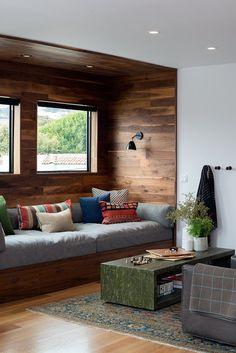 San Francisco Interior Design company Regan Baker Design - Glen Park Spanish Modern Custom Built-In Sofa, Living Room, Wood Cladding Wall, Niche, Midcentury Modern, Blanket Hooks Storage