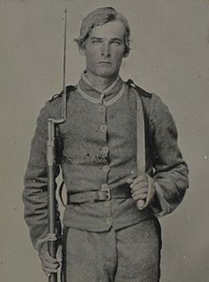 Unidentified soldier in Confederate uniform with musket and D-guard Bowie knife