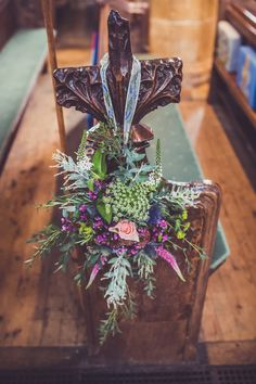 Floral decorations for the church pew ends - Image by Claire Penn Photography - Suzanne Neville Lace Wedding Dress & Kurt Geiger Shoes for a Rustic Village Hall Venue decorated with gorgeous Bright Flowers, DIY Decor & Light Up Letters.