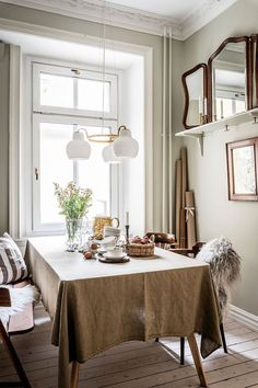 my scandinavian home: An Earthy Swedish Apartment Where Old Meets New Scandinavian Style Home, Scandinavian Design, Lime Paint, Beige Sofa, White Side Tables, Dining Room Design, Dining Rooms, Cozy House, Bedroom Wall