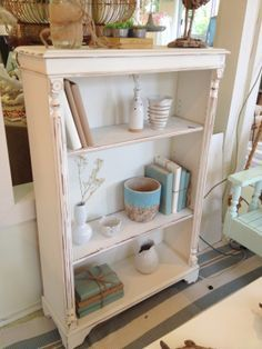 Distressed white shelves with blue trimmings are the perfect example of a beachy vibe :) http://www.redinkhomes.com.au/