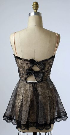 Darling black lace teddy with bows up the back, ca. 1956.