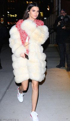 Wrap it up! As she left the taping of the show, the Victoria Secret model put a warm fur coat around her shoulders