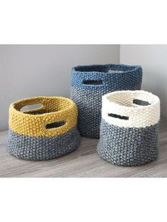 These 3 baskets are great for storing everything from yarn scraps and full skeins to home odds and ends. The handles make them easy to move from room to room and take with you wherever you go! Knit with 2 (2, 4) skeins MC and 1 skein CC of Plymouth Y...