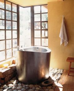 Japanese soaking tub -  love the rocks underneath this tub & it's even inside @Matt Nickles Nickles Hart  you could build me this out of wood, off grid of course. : )