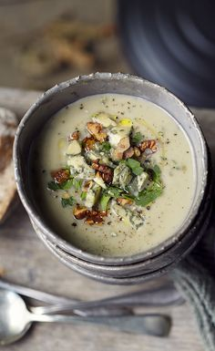 Creamy cauliflower, pear and blue cheese soup topped with chopped walnuts