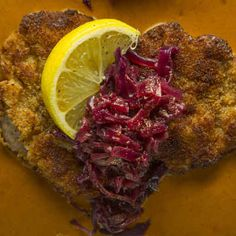 Pork Schnitzel with Slow-Braised Cabbage and Paprika-Cream Sauce: Sweet cabbage, slowly-braised in red and white wine, cuts through the richness of Tim Wiechmann&