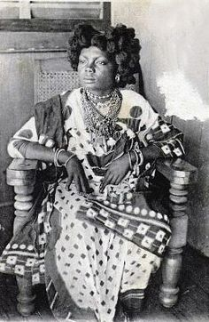 Africa | Portrait of aNossi-Bé woman. Madagascar, Antsiranana province. | Postcard image;Grand Bazar Charifou Jeewa. ca. 1906