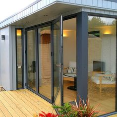 Our Malvern Custom Built Studio takes your own design ideas and turns them into reality! In this picture we've added Aluminium Bi-folding doors to give that contemporary feel! Folding Patio Doors, House Yard, Garden Studio, Garden Office, Garden Inspiration, Home And Garden, Garden Sheds, Offices, Building