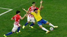Brazilian striker, Fred, goes down in the box against Croatia in the tournament opener.