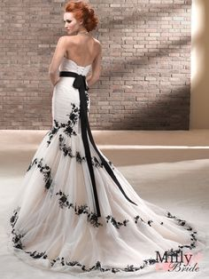 Black lace helps a wedding dress capture a dramatic look ~ Make sure to check our our next issue to see our modern wedding dresses!