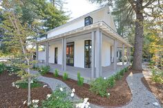 Contemporary Porch with exterior stone floors, Paint1, Pathway, Wrap around porch