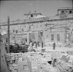March 1942 21 1942 Heaviest bombing raid on Malta yet. Bomb damage to the motor transport depot of 32nd Company, Royal Army Service Corps at Floriana, 20 March 1942.