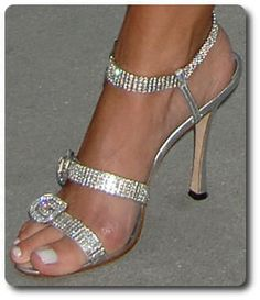 Manolo Blahnik sandal heel is gorgeous ... but this is a no-no for this foot ... if your toe is hanging off the shoe like that, go up at least half a size ... and this is obviously not the only shoe worn too small judging from that sore spot on the side of her foot .... tisk tisk