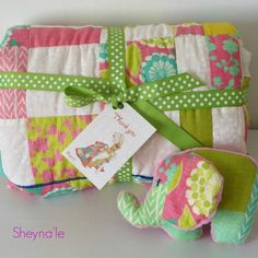 With modern design and white background - Chevron, dots, pretty flowers, sweet colors and fun prints, This bright baby quilt has it all ! The owner of this quilt has found her - well, her grandma did סמל ההבעה smile  on its way to warm and cuddle #sheynale