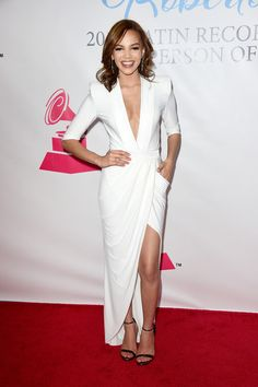 Leslie Grace looked fierce in a white tuxedo dress with a navel-grazing neckline and a high front slit during the Latin Grammy Person of the Year event.