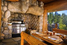 """Massive stone surround for outdoor grill. Stone """"mantle"""" especially cool. Pioneer Log Homes of British Columbia"""