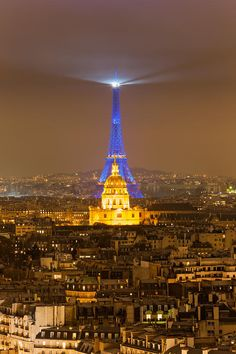 Eiffel Tower lighthouse and the Invalides by night, Paris