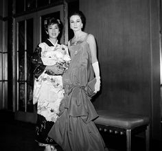 """This Nov. 20, 1959 file photo shows Viscountess Jacqueline de Ribes, right, with actress Miiko Taka from the film, """"Sayonara,"""" at the Embassy Ball at the Waldorf Astoria in New York. Dresses, including this one worn by the French style and fashion icon, are part of an exhibit, """"Jacqueline de Ribes: The Art of Style,""""opening November 19 at the Costume Institute at the Metropolitan Museum of Art in New York. (AP Photo/Marty Lederhandler, File)"""