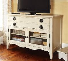 nice piece of furniture.  Could take out any drawers in a dresser and convert to glass doors for video equip