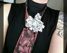 Upcycled ties make great necktie necklaces for fashion adventurous gals. Desert Pearl Designs has many styles and colors available. Come find yours!