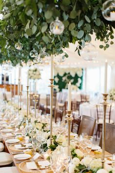 2a3c28e3fe75 C   As beautiful wedding last summer! The head table featured a beautiful  floral tablescape of greens roses and ranunculus and tall tapered candles.