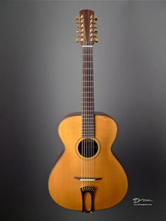 Stefan Sobell 12 String : The archtop creates just the right separation between the notes and make the pairs of strings discrete and clear. European spruce top, Indian rosewood back & sides.