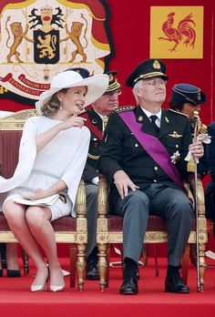 Queen Mathilde (L) and King Philippe - Filip (R) of Belgium attend the military parade on the Belgian National Day on July 21, 2015 in Brussels