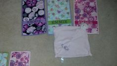 Burp cloths made with flannel and ribbon.  Cloth animal bought and embroidered with initials.