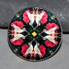 Hummingbird Magnet Glass Geometric Kaleidoscope Mandala Tiny Dancer <br /> <br />Hummingbird geometric mandala kaleidoscope glass bead magnet. Magnet is 50mm (just under 2 inches) and has a powerful magnet for secure placement on your fridge or magnetic surface. I have attached my kaleidoscope photo and applied a protective acrylic finish. <br /> <br />The ...