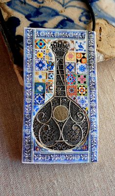 Beautiful tile of a Portuguese Fadista Guitar