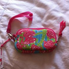 Lilly Pulitzer Tech Case As bright and cheery as only Lilly does!! Perfect size for phone, etc and includes a inside storage pocket and wrist strap! Lilly Pulitzer Accessories Phone Cases