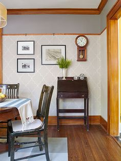 We love the woodwork in this dining room. The picture rail in the dining room was added and stained to match the existing baseboards.