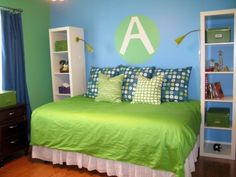 Green and Blue.  Like the bookcases on either side of the daybed.  Like the square pillows instead of shams.