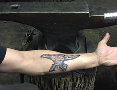 """Hay Budden anvil tattoo I had done today by my buddy Stephan """"Lefty"""" Lanphear, @leftysworldfamous He is amazingly talented and has an incredible story of being the person who fought the State of Massachusetts to legalize tattooing and after a long battle won. His story even made The New Yorker Mag. His story reminds me of Jimmy Stewart in Mr. Smith Goes to Washington. Stephen is a diversely talented artist, tattooist , blacksmith , machinist and  great friend. #blacksmith #haybud..."""