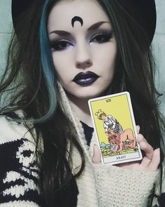 STRENGTH for this year  #witch #tarotgirl #tarotcollector #tarot #witchery #witches #wicca #pagan #tarotcards #moonchild #gothic #goth #alternativegirl #alternative #makeup #darkmakeup #purplelipstick #lipstick #eyeliner #eyebrows #bluehair #gothicgirl #gothgirl #altgirl #motd #lotd #ombrelips #spooky #boho #grunge