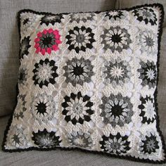 Black and white granny square pillow with pop of color. Very interesting. Love it!