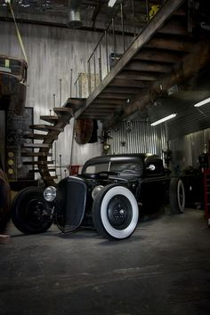 Hot Rod parked under loft in industrial looking warehouse shop